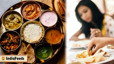 indian woman eating in restaurant